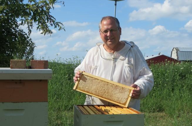 Tim with hive.jpg